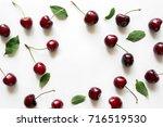 creative fresh cherry pattern... | Shutterstock . vector #716519530
