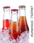 Soda Bottles in Ice Bucket isolated over white - stock photo