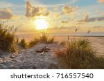 sunset at the beach of nes on... | Shutterstock . vector #716557540
