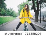Cheerful Woman Riding Bicycle...