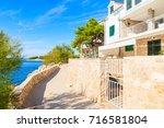 apartments on coastal path... | Shutterstock . vector #716581804