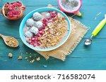 healthy breakfast bowl. yogurt  ... | Shutterstock . vector #716582074