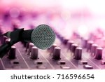 close up microphone on blur... | Shutterstock . vector #716596654
