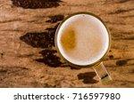 glass beer  top view on wood... | Shutterstock . vector #716597980