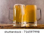 beer in mug on wooden table... | Shutterstock . vector #716597998