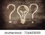 question sign with bulb on... | Shutterstock . vector #716603050