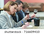 Small photo of critics grading the wines for the awarding