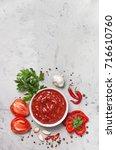 tomato sauce in a white bowl ... | Shutterstock . vector #716610760