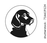 logo in the shape of a dog....   Shutterstock .eps vector #716619124