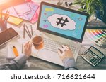 Small photo of hashtag post viral web network media tag business topics topic success laptop notebook content sharing concept - stock image