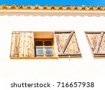 window shutters on an old... | Shutterstock . vector #716657938