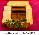 window shutters on an old... | Shutterstock . vector #716658064