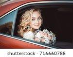 lovely young bride in wedding... | Shutterstock . vector #716660788