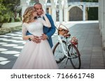 bride and groom with a bicycle... | Shutterstock . vector #716661748