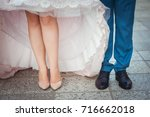 legs in the shoes of newlyweds... | Shutterstock . vector #716662018