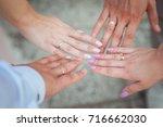 hands of the newlyweds. happy... | Shutterstock . vector #716662030