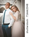 a lovely couple of newlyweds.... | Shutterstock . vector #716662048