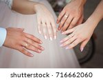 hands of the newlyweds. happy... | Shutterstock . vector #716662060