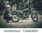 mechanic with motorcycle ... | Shutterstock . vector #716663824