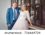 a lovely couple of newlyweds.... | Shutterstock . vector #716664724