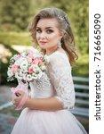 lovely young bride in wedding... | Shutterstock . vector #716665090