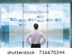 person looking at blockchain... | Shutterstock . vector #716670244
