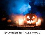 glowing halloween pumpkin with... | Shutterstock . vector #716679913