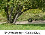 tire swing on tree | Shutterstock . vector #716685223