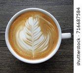 top view of a mug of latte art...   Shutterstock . vector #716687584