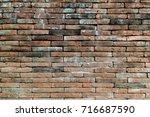 grunge brown brick wall texture....   Shutterstock . vector #716687590