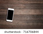 mobile phone with blank screen... | Shutterstock . vector #716706844