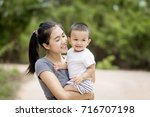mother play enjoying with her...   Shutterstock . vector #716707198