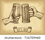 hands holding and clinking beer ... | Shutterstock .eps vector #716709460