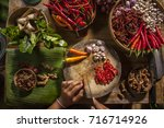 chop a chili in a thai kitchen | Shutterstock . vector #716714926