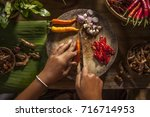 chop a chili in a thai kitchen | Shutterstock . vector #716714953