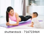 asian mother fit and play yoga... | Shutterstock . vector #716723464