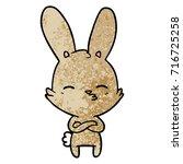 curious bunny cartoon   Shutterstock .eps vector #716725258