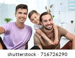 happy male gay couple with... | Shutterstock . vector #716726290