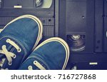 youth sneakers lie on video... | Shutterstock . vector #716727868