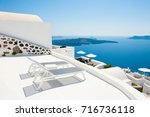 two sunbeds on the terrace with ... | Shutterstock . vector #716736118