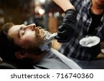 shaving ritual in barbershop  ... | Shutterstock . vector #716740360