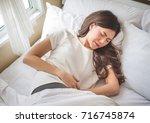asian woman stomachache  feel... | Shutterstock . vector #716745874