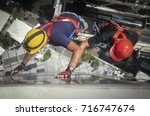 two workmen on a suspended... | Shutterstock . vector #716747674