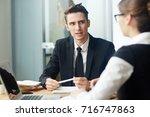 confident young entrepreneur...   Shutterstock . vector #716747863