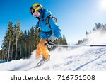male skier skiing on fresh snow ... | Shutterstock . vector #716751508