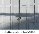 the white wooden doors that... | Shutterstock . vector #716751880