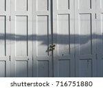 the white wooden doors that... | Shutterstock . vector #716751880