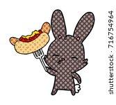 curious bunny cartoon with...   Shutterstock .eps vector #716754964