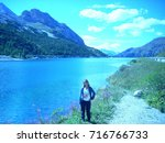 a girl on fedaia lake in the... | Shutterstock . vector #716766733