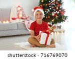 Happy Little Boy With Christma...